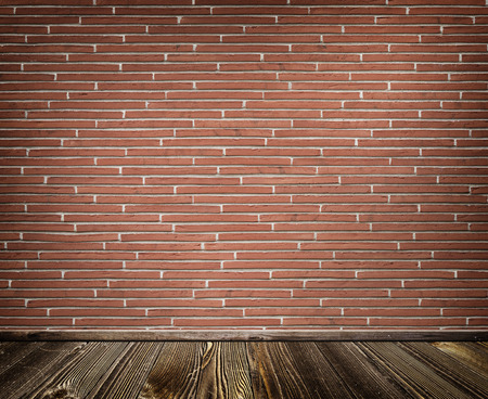 red brick wall: Red brick wall and old wooden floor.