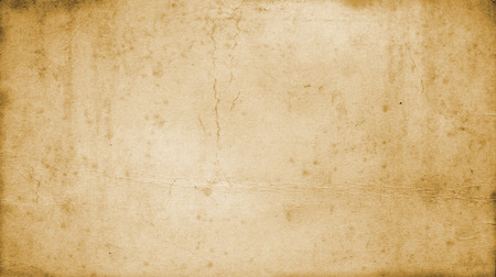 aging: Aging paper background. Natural old paper texture for the design. Stock Photo