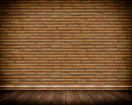 baseboard: Brick wall and wooden floor with skirting board. Stock Photo