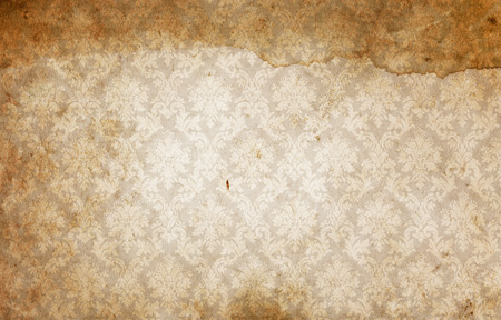 old wallpaper: Dirty and spotted paper with vintage decorative ornament. Old wallpaper background.