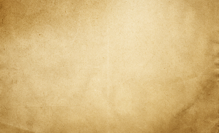 Aging paper background. Natural old paper texture for the design. Stock Photo
