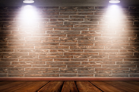 brick floor: Red brick wall and old wooden floor illuminated by lamps.