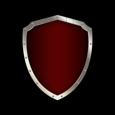 chrome border: Red shield with chrome riveted border on black background. Stock Photo