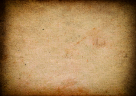 aging: Aging stained paper background with vignette effect. Stock Photo