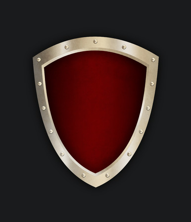 riveted: Old shield with riveted border. Isolated on black background.