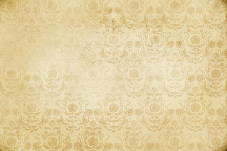 昔ながらの花のパターンと黄ばんだ紙の背景。デザインのビンテージ紙のテクスチャです。