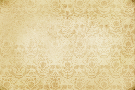 yellowed: Yellowed paper background with old-fashioned floral patterns. Vintage paper texture for the design. Stock Photo
