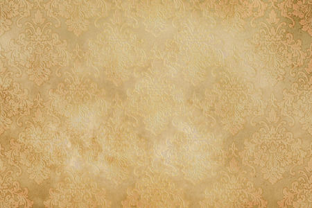 yellowed: Old yellowed paper background with decorative vintage patterns, Vintage paper texture for the design.