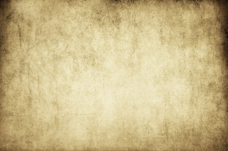 Aged dirty paper background or texture for the design. Vintage paper background woth copy space for the text.