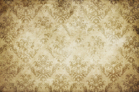 old wallpaper: Aged dirty and yellowed paper background with shabby vintage patterns. Vintage paper texture for the design.