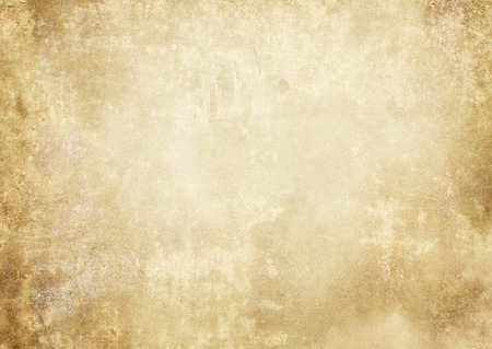 Aged and yellowed paper background. Vintage paper texture for the design. Stock Photo
