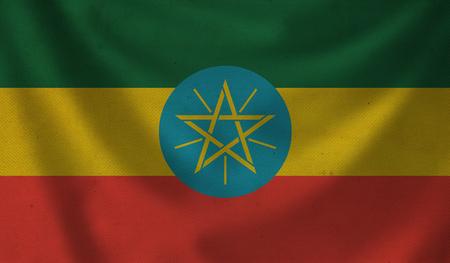 Vintage background with flag of Ethiopia. Grunge style.