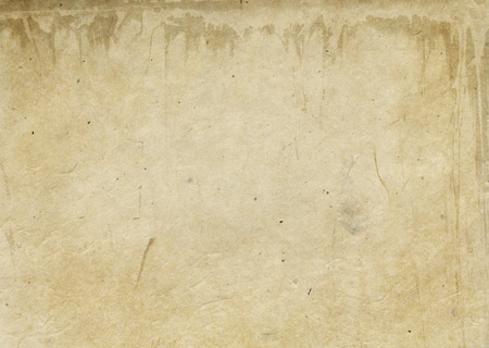 Aged rough paper background or texture for the design. Grunge paper background. Stock Photo