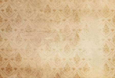 Old dirty and shabby paper background with vintage floral patterns. Old wallpaper background.