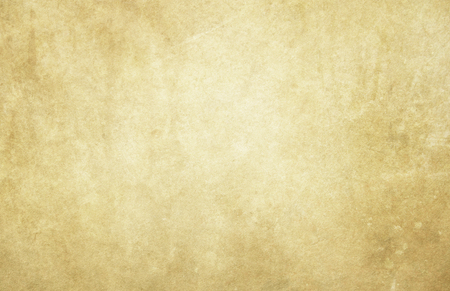 Aged and yellowed paper texture for background.