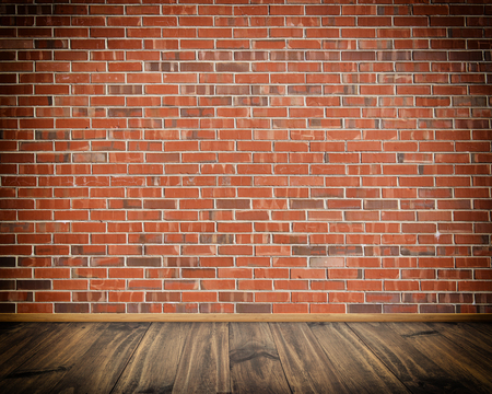 Red brick wall and wooden floor background.