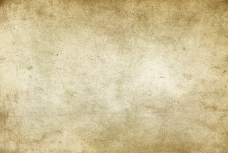 Aged dirty and yellowed paper texture for background.
