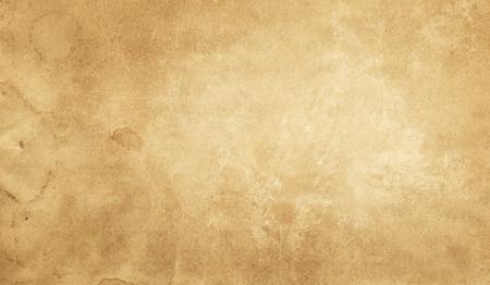 背景に黄色のグランジペーパーまたは羊皮紙のテクスチャ。