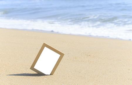 Blank white paper on wood frame beach sand summer photo