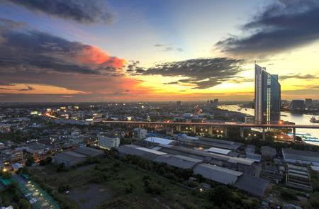 urban scene: Bangkok office building riverside at sunset, before Night Falls, Panorama picture Stock Photo