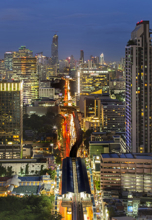 Bangkok office building with sky train at twilight
