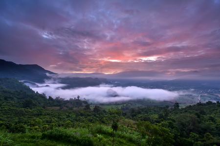 Sunrise and Mist, Doi Phulangka, rainy season, Province Phayao, Thailand Stock Photo
