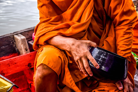 come in: Buddhist tradition in every morning but a little different in Amphawa because monks come by a boat