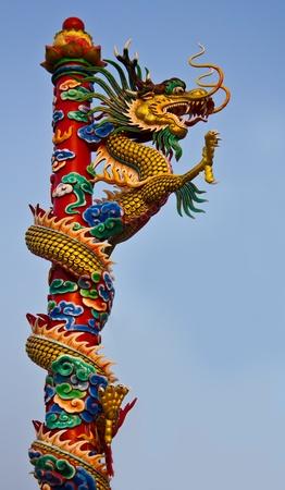 a dragon climbs a pole very high Stock Photo - 9420415