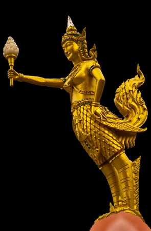 Kinnaree golden statue holding the torch.