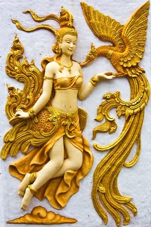 asian angel: Stucco walls Kinnaree golden birds swan. Stock Photo