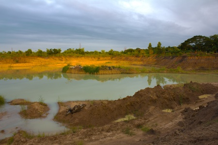 Land and a large pond on the farm in Thailand. Stock Photo