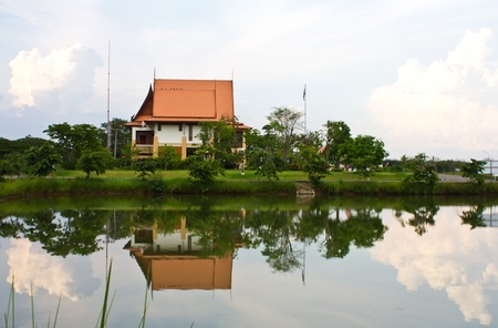 Thai-style clock tower with a traditional boat race pictures.