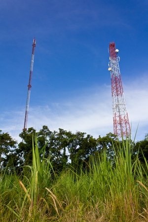 telecommuting: Antennas transmit and receive signals via satellite to use telecommuting. Stock Photo