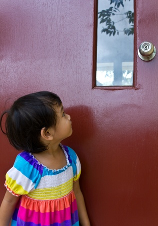 Thai children stared at the door to doubt and fear. Stock Photo - 10875060