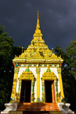 Golden Square Pagoda in the Forest. photo
