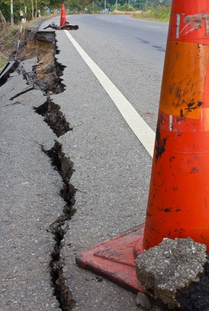 Side along the asphalt road collapsed because of erosion. Stock Photo - 11542472
