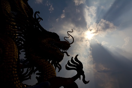 Statue of a golden Dragon a large sky conspicuously. Stock Photo - 11893428