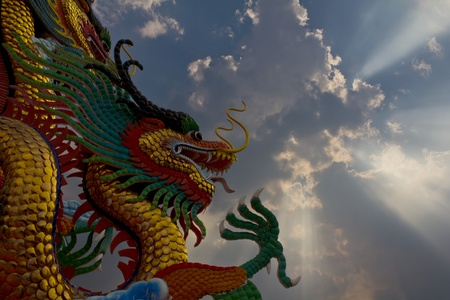 Statue of a golden Dragon a large sky conspicuously. Stock Photo - 11893431