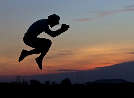 Jumping cameraman Stok Fotoğraf