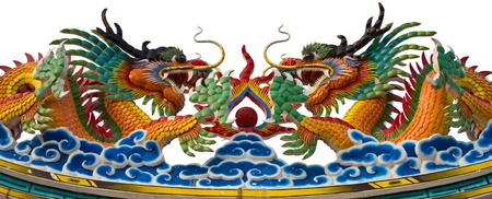 Two dragon statues face each other on the roof. Stock Photo