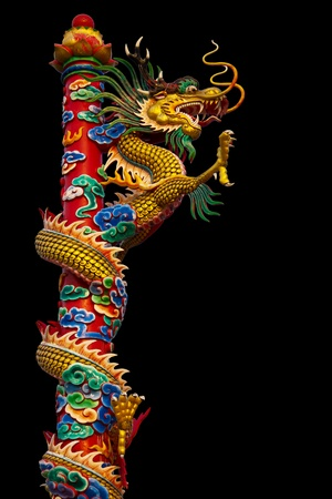 Dragon statues are climbing poles towering spectacular. Stock Photo - 12025450