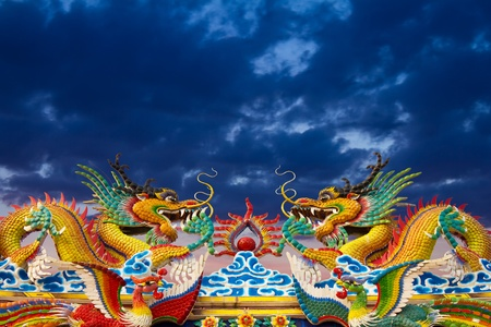 Golden Dragon statues, two on the roof gracefully. Stock Photo - 12065078
