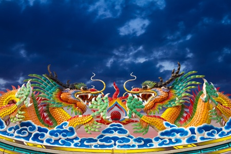 Golden Dragon statues, two on the roof gracefully. Stock Photo - 12065077