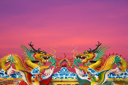Golden Dragon statues, two on the roof gracefully. Stock Photo - 12065080