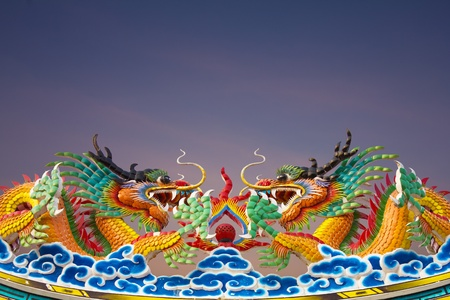 Golden Dragon statues, two on the roof gracefully. photo