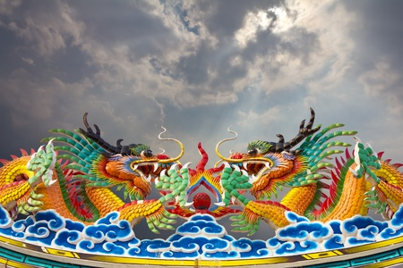 Golden Dragon statues, two on the roof gracefully. Stock Photo - 12065081