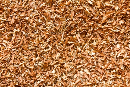planer: Brown sawdust from hardwood  Stock Photo