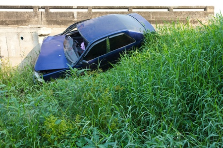 Car accident and fell into the bushes near the bridge  photo