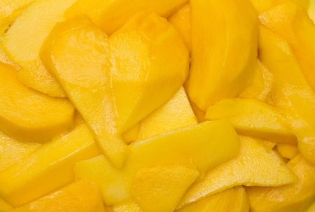 Heart-shaped yellow piece of ripe mango