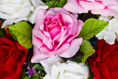 Details of artificial roses, pink, yellow and white  photo